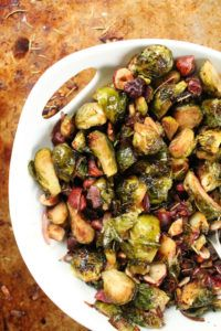 Perfectly tender roasted Brussel Sprouts tossed together with roasted hazelnuts and dressed in a sweet maple balsamic glaze