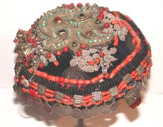rare, full original headdress from Uzbekistan. Silver gilt , glass and semi precious stones, coral , coins on wool with silk embroidery. 19th c. (archives sold Singkiang)
