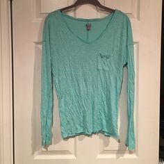 EUC  Aerie long sleeve tee! So soft! Pretty Mint EUC  Aerie long sleeve tee! So soft! Pretty Mint/Aqua color. Pocket on front. Fats shipping &I bundle discount aerie Tops Tees - Long Sleeve