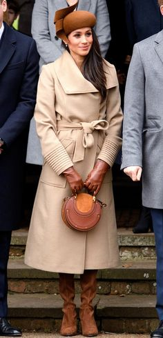 Meghan Markle in a camel coat, brown hat, Chloe bag and brown suede boots for Christmas