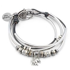 The Mini Dixie with Elephant Charm leather wrap bracelet features 2 strands of leather, silverplate crescents and a silver elephant charm that comes attached. Handmade in the USA and designed to be worn as a charm bracelet only.