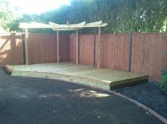 Raised curved decking incorporating corner pergola.
