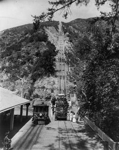 (1893)* - View of Mount Lowe's cable incline. A group poses in the car at the bottom of the incline and in front of the Mount Lowe trolley.