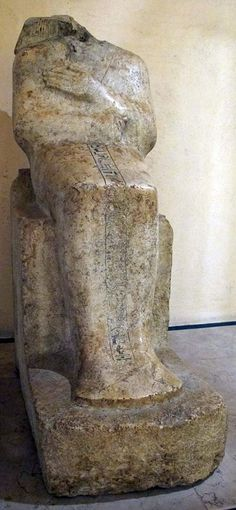 Headless Statue of Hapuseneb,High priest of Amun & influential supporter of Hapshepsut.He was related to the Royal family through his mother Ahhotep,who was a member of the royal harem.Today,little record survives of him.He is listed as having had a fairly large family(3 sons,& 4 daughters)- with his wife.From the few paintings one can see on his badly damaged tomb,one can see an account of Hapshepsut's expedition to Punt;he must have been somehow involved,or he would not have listed it as…