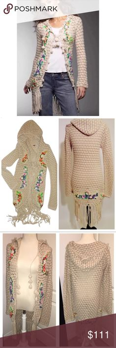 RARE Free People Crochet Granny Floral Cardigan Fringed hem, ties in front, little tassels on the hood and gorgeous flowers on the sweater. This is hard to find. Please note, one of the top ties is missing but you can still tie it and wear it or leave it open. This is an amazing sweater. So boho. Size medium open front cardigan duster style longer fringed sweater Free People Sweaters Cardigans