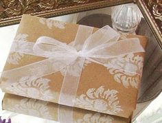 Brown Paper, hand-stamped with white decorations...tied with sheer white ribbon! Grocery Bag Gift Wrap