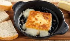 "Saganaki recipe from: ""In the Kitchen with Stefano"" This pan-seared cheese made with ouzo is a restaurant favourite that will have everyone shouting OPA! If you can't find kafalograviéra cheese, substitute kasseri, kefalotyri or halloumi. Greek Appetizers, Appetizer Recipes, Snack Recipes, Cooking Recipes, Snacks, Cooking Ideas, Turkish Recipes, Greek Recipes, Saganaki Recipe"