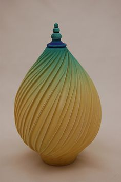 This is porcelain, but could work beautifully in polymer clay.  Vase or finial by Natalie Blake