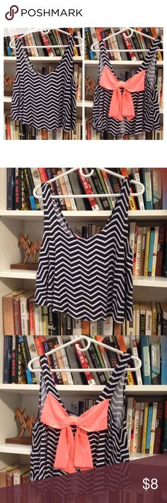 Huge bow crop top Charlotte Russe crop top with funky bow on back. This crop top is lose and stretchy and is split for an open back (see photos). Color is navy blue. Charlotte Russe Tops Crop Tops