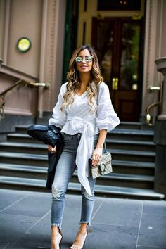 Fashion blogger Mia Mia Mine wearing a white top and gray jeans from express in Melbourne Australia