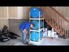 water storage system - so want to do this in my garage. Emergency Preparation, Emergency Preparedness, Water Barrel Storage, Rain Barrel System, Off Grid Survival, Raspberry Plants, Water Powers, Water Collection, Food Storage