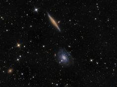 These two spiral galaxies make a photogenic pair, found within the boundaries of the northern constellation Draco. Contrasting in color and orientation, NGC 5965 is nearly edge-on to our line of sight and dominated by yellow hues, while bluish NGC 5963 is closer to face-on.