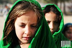 School girls with green headscarves near the city of Mingora in Swat District of Khyber Pakhtunkhwa, Pakistan.