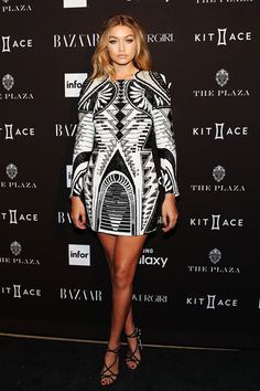In case you haven't already circled November 5 on your calendar, Gigi Hadid will get you racing for a big, red marker. The model is the latest of Olivier Rousteing's inner circle to debut an item from Balmain's upcoming collaboration with H&M, set to drop this fall. Hadid stepped out at the