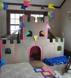 Have you ever wondered why we even bother buying our kids toys when all they really want is the cardboard box to build a fort? Grab your kids, and some scissors, and get ready to make some memories with these creative ideas for cardboard forts. Cardboard Houses For Kids, Used Cardboard Boxes, Cardboard Castle, Cardboard Playhouse, Diy Cardboard, Cardboard Box Ideas For Kids, Cardboard Furniture, Playhouse Furniture, Kids Crafts