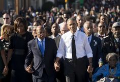 US President Barack Obama walks alongside Amelia Boynton Robinson (R), one of the original marchers, the Reverend Al Sharpton (2nd R), First Lady Michelle Obama (L), and US Representative John Lewis (2nd-L), Democrat of Georgia, and also one of the original marchers, across the Edmund Pettus Bridge to mark the 50th Anniversary of the Selma to Montgomery civil rights marches in Selma, Alabama, March 7, 2015. The event commemorates Bloody Sunday, when civil rights marchers attempting to walk…
