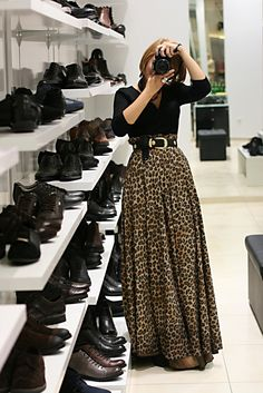 I couldn't pull this off, but I have a friend who totally could! || high-waisted leopard print maxi skirt belted with black blouse
