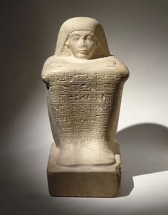"""Block Statue of Ay, ca. 1336-1327 BCE (not the king, but perhaps a relative) who achieved the exalted religious positions of Second Prophet of Amun and High Priest of the Goddess Mut at Thebes. His career flourished during the reign of Tutankhamun, when the statue was made. The cartouches of King Ay, Tutankhamun's successor appearing on the statue, were an attempt by an artisan to """"update"""" the sculpture. Limestone,  Brooklyn Museum, Charles Edwin Wilbour Fund"""