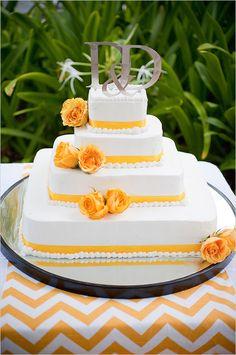 yellow and white wedding cake