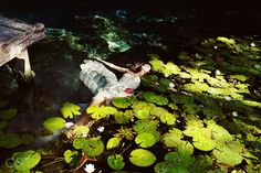 Riviera Maya Photography Cenote Trash the Dress, love in the lily pads.  Mexico wedding photographers Del Sol Photography
