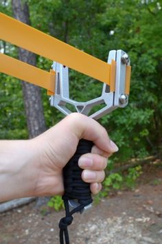 """Be the coolest kid on the block again with this high tech slingshot. The aluminum frame is cut from 1/2"""" thick aluminum plate with a waterjet at 50,000 psi for unrivaled strength and low weight. Then we either powdercoat or anodize the aluminum frame (depending on the color)."""