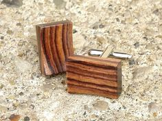 Circle Road Design presents a pair of cufflinks in exotic Brazilian Kingwood. Theyre finished with a lacquer clearcoat, and affixed to bright silver toned metal links. Each cuff link is handmade in Lake in the Hills, Illinois from select premium hardwoods from around the world and comes delivered in a gift box. Each cuff link measures 1/2 x 3/4  Free shipping to USA  Since every piece of wood is unique, there might be slight differences from the representative picture shown above. F...