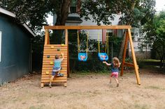 Build your own DIY swing set—complete with a climbing ladder and rock wall—using our step-by-step guide. Wooden Swing Set Plans, Build A Swing Set, A Frame Swing Set, Backyard Swing Sets, Diy Swing, Wooden Swings, Backyard For Kids, Swing Sets Diy, Wooden Swing Frame