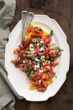 An easy summer side dish made with a simple tomato salad that tops easy fried polenta. Polenta can also easily be grilled for crispness.