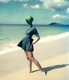 Lovely vintage fashion shoot with green hat on the beach