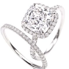 LOVE!!!... I love the princess cut halo set engagement ring... I prefer a thicker band though- lol... Ive got chubby fingers. ......