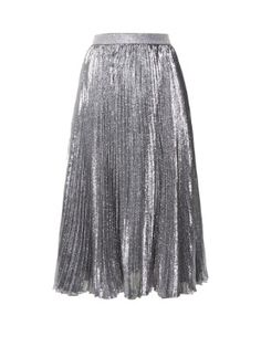Command attention in Christopher Kane's lustrous metallic-silver Lurex midi skirt. It's designed with a high-rise waist and falls to the calf in sharp pleats. Wear it from day to night with a knitted top and studded ankle boots.