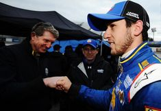 Chase Elliott made his NASCAR Cup Series debut on March 27, 2015, at Virginia's Martinsville Speedway. He's congratulated by his father, NASCAR Hall of Famer Bill Elliott, after qualifying. Bill Elliott, Chase Elliott, Martinsville Speedway, Photo Caption, Fox Sports, Father And Son, Embedded Image Permalink, Nascar, Race Cars