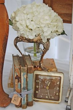 twiningvines:  Beautiful vintage display  … i have the exact clock at the store … and what a great use for warming dish stands &...