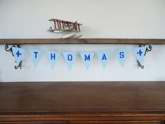 Creative a custom name airplane banner for your little boy's room. Blue felt plane bunting. By SweetThymes.etsy.com