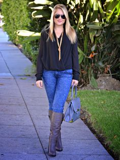 Casual Fall Style: Pair a chic chiffon drape-front black top with skinny denim, steel grey boots with buckle detail and a structured grey handbag with gold and silver hardware. Accessorize with a gold rope knot necklace and a chic white + gold watch from Pulsar. (Featured Brands: CAbi Clothing, JustFab, @marshalls, Deb Shops)