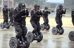 Armed police in Jinan, China demonstrate a rapid deployment exercise during a training drill almost a month before the Olympic Games