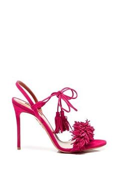Conceived by Colombian-born footwear connoisseur Edgardo Osorio, Aquazurra effortlessly combines the artistic craftsmanship and glamorous allure. Masterfully produced in Italy with the finest suede, these **Aquazurra** high-heel sandals dazzle with a playful, fringed detail and a bright pink hue.