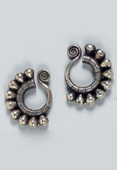 Southwest China - Guizhou   Pair of Miao woman's earrings; hollow silver.  Ø 6.5 cm.   Est. 650 - 700€ ~ (Dec '14)