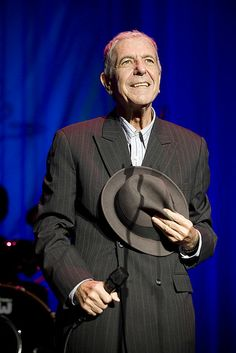 Leonard Cohen at The Brighton Centre. Old, ill, thin, but a miraculous man, poet and songwriter. So utterly charismatic and compelling that both men and women just love him./Here is a man that I would marry, no matter how old he  may be ;)