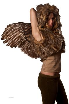faux owl-feather vest with wings.