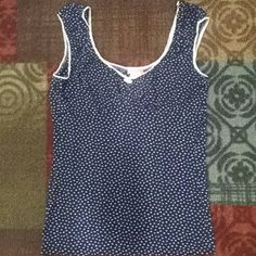 Adorable dark blue dress top Soft and slick dark blue top with white spotted detail. Shown on to better show the fit. I always wore this with a lace Cami as shown. Body Central Tops Blouses