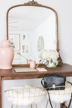 Apartment of MoneyCanBuyLipstick.com, Anthropologie Mirror, Gold Oversized Mirror, Faux Fur Bar Stools, Faux Fur and Gold Bar Stools, Blush Pink Ginger Jar, Cozy Neutral and Blush Living Room - Money Can Buy Lipstick