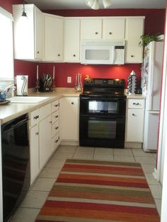 fascinating paint colors for small kitchens with white cabinets inside small kitchen paint colors Best Small Kitchen Paint Colors Ideas 2018 Red Kitchen Accents, Black And Red Kitchen, Red Kitchen Cabinets, Paint For Kitchen Walls, Red Kitchen Decor, Kitchen Paint Colors, White Cabinets, Kitchen Ideas, Kitchen White