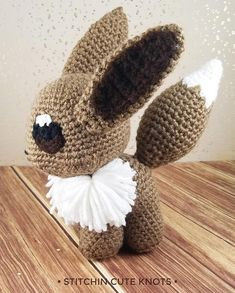 Amigurumi Eevee - Crochet Eevee - Pokemon Nintendo Doll This Amigurumi Eevee is here to stay! As the #133 Pokémon it has the unique ability to evolve into one of eight different Pokémon! About this Product: + Eevee measures 7 inches (17.78 cm) tall from toes to ears and 6.5 inches (16.51 cm) long from nose to tail. + 100% Acrylic yarn + 100% Polyester fiberfill stuffing All Pokemon have sewn on eyes and details making them safe for young children.