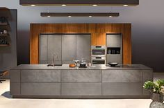 DESIGNING KITCHENS - OLD VALUES, NEW IDEAS, FRESH CONSTITUENTSShining surface finishes and matt elegance meet fresh colours. Dialouge of design and material inspires a new interpretation of tradition