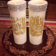 Islamic decorated candle set.  Hand painted.  Bling added on top.  Wick taken out and a space provided for a tea light.  Burn the tea light and never ruin the candles.  Sale price $42.00