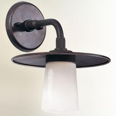 $164 Edison Outdoor Wall Light with Americana Bronze Finish by Restoration Warehouse. Glassware: Opal White Glass. Metalwork:   Wrought Iron and Aluminum. Available in Small, Medium and Large.