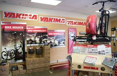 """Inside Rack N Road Sacramento, CA showing off our variety of Yakima roof and car rack systems. Try one of our unique boat mounts with our """"Try Before You Buy"""" program"""