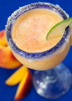 Peach Coco Bongo Daiquiri >>> •2 oz Malibu Coconut Rum •3 oz Sweet & Sour Mix •½ fresh ripe Peach •splash of Grenadine