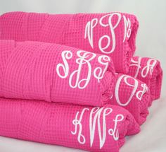 pink robes with white monograms